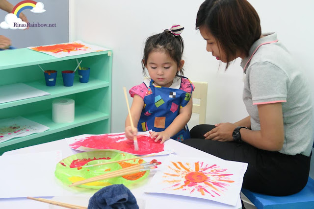 Painting with teacher