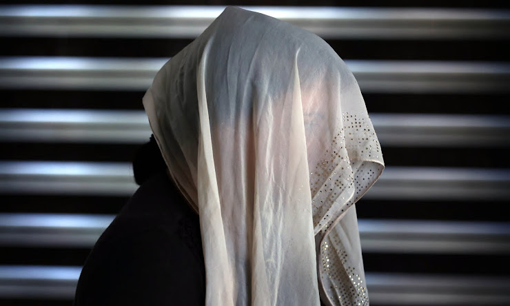 A displaced Iraqi woman from the Yazidi community