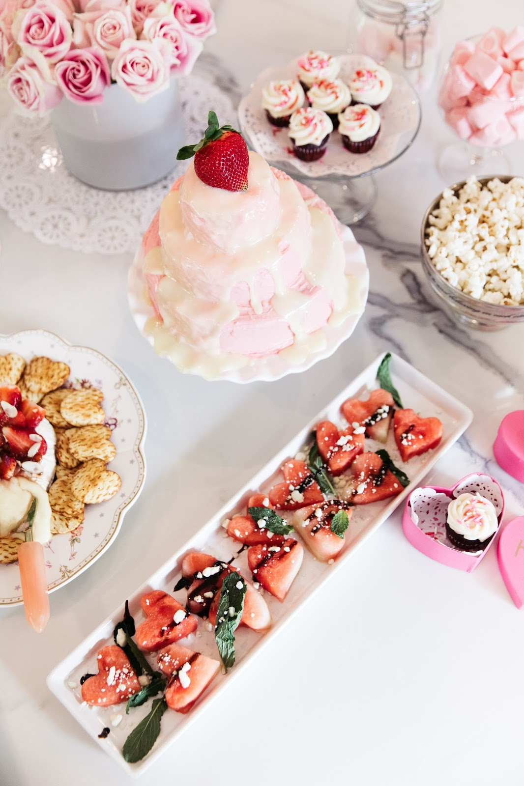 A chic spread of sweet and savory treats for your galentine's day party
