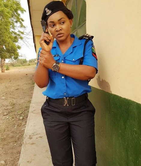 Mercy Aigbe seen with a gun as she rocks Police uniform in new photos