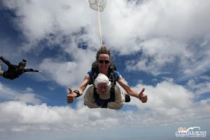 Old Woman Becomes Oldest Skydiver, Flies Down From The Sky To Celebrate 102 Years Birthday (Photos)