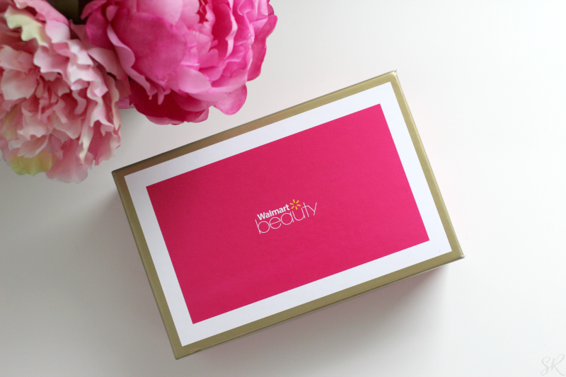 a Walmart pink beauty box on a white table with pink flowers