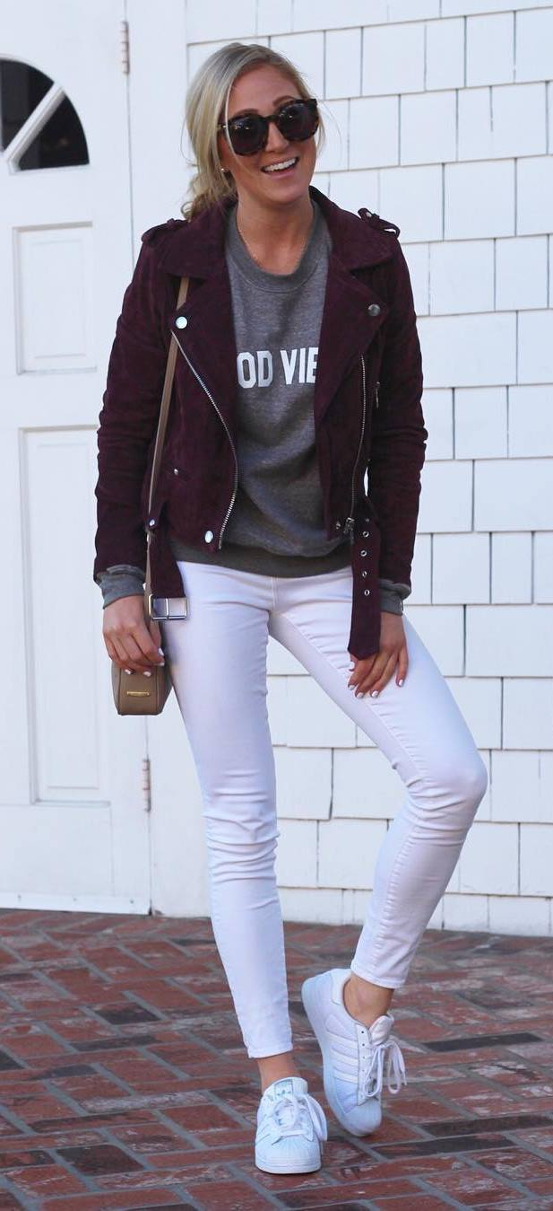 trendy fall outfit : maroom biker jacket + sweatshirt + white skinnies  + sneakers