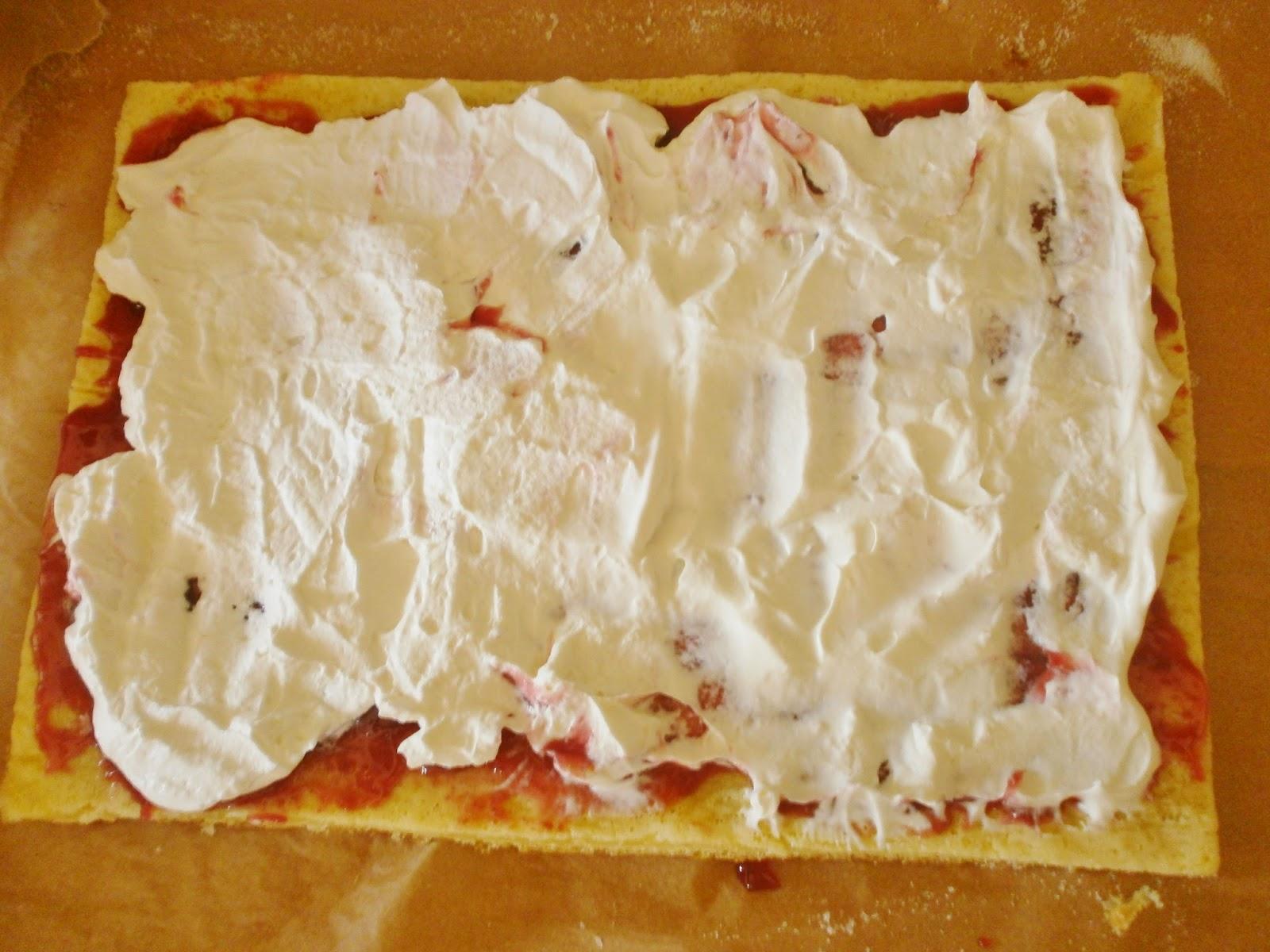 Jam and cream in homemade swiss roll