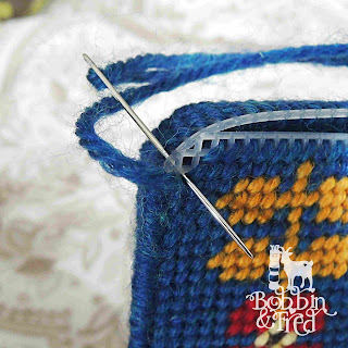 pass the needle through all of the holes to cover plastic canvas when sewing around a corner