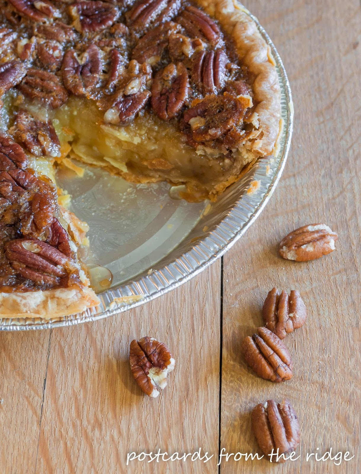homemade pecan pie with a piece missing