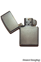 Cramer Imaging's photograph of a open silver Zippo brand lighter on a white background