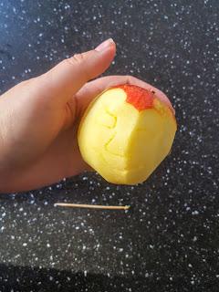 Toothpick carving Shrunken Apple Head