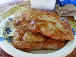 Paper Plate Stacked with Barbecued Pork Chops
