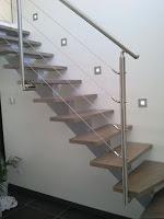 escalier limon centrale metalique garde corps inox marche bois spot design comtemporain