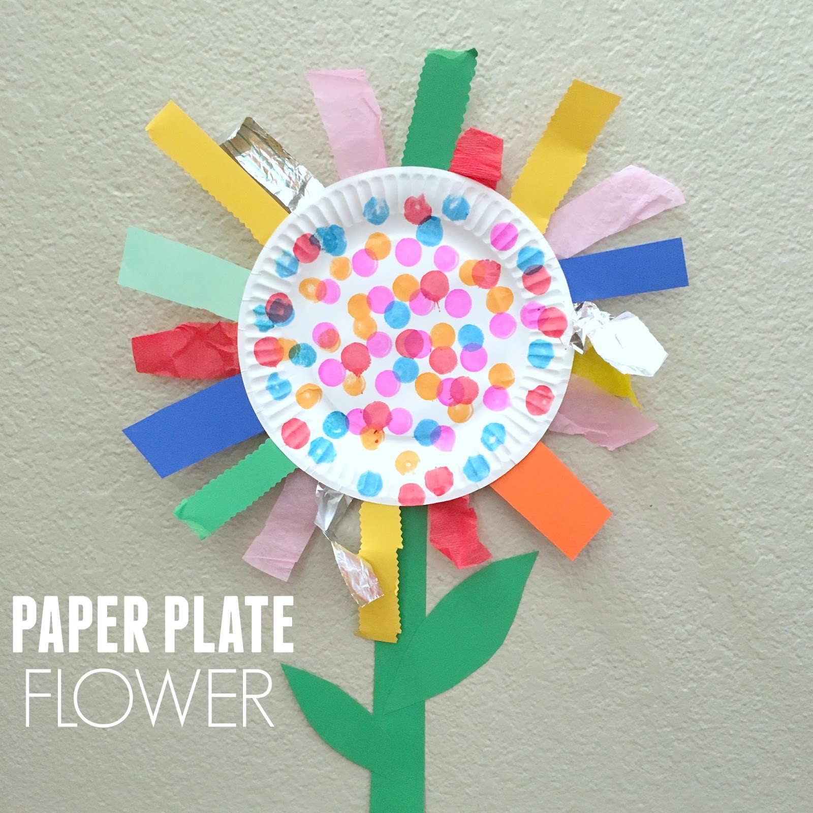 Paper plate flower fine motor craft toddler approved bloglovin some cut strips and made a collage and some decided to use a spring theme to create a paper plate flower mightylinksfo