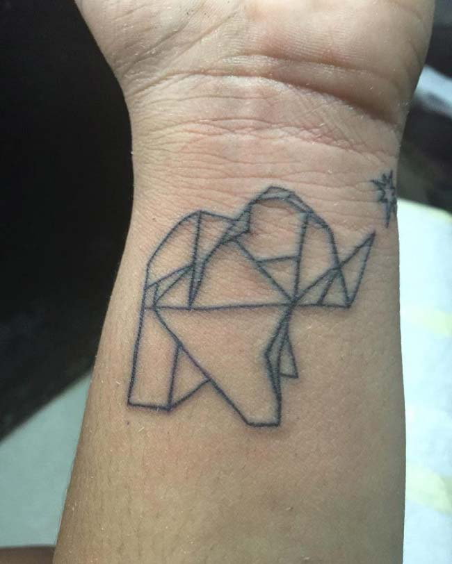 prisma minimal elephant tattoo