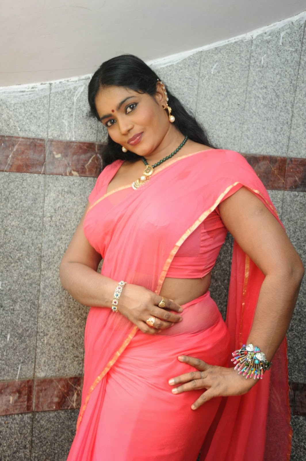 AUNTY HOT: Sexy Jayavani In Orange Saree