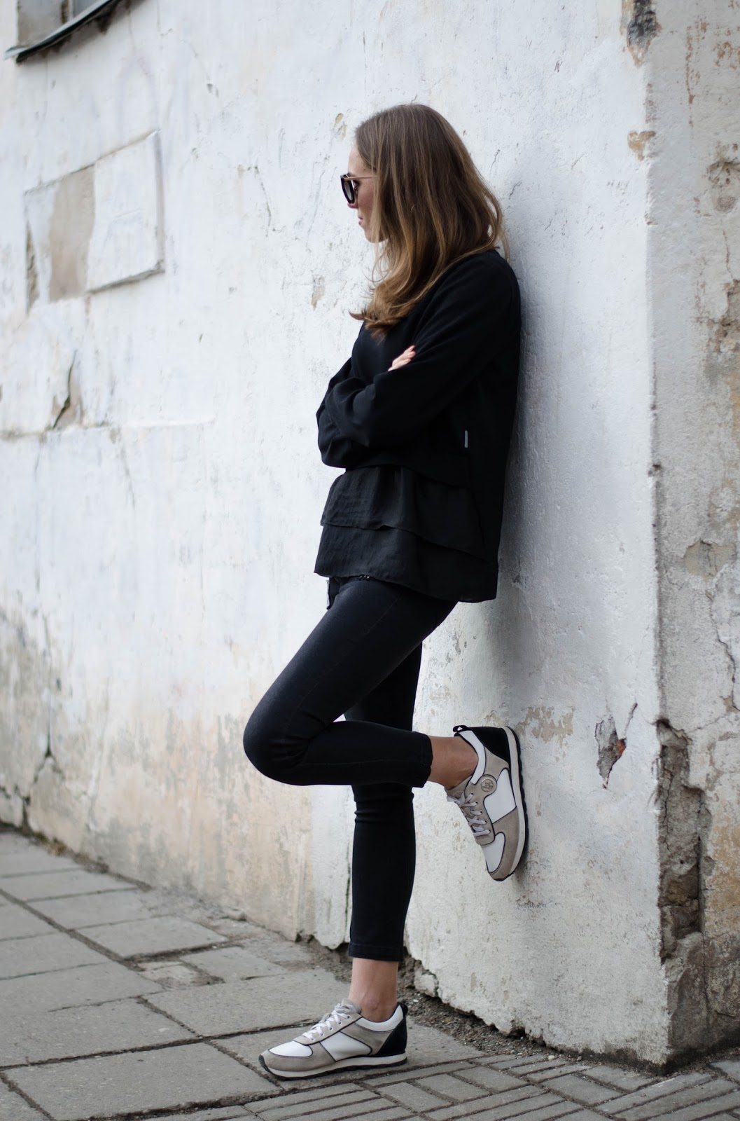 kristjaana mere black sweater jeans sneakers casual spring look