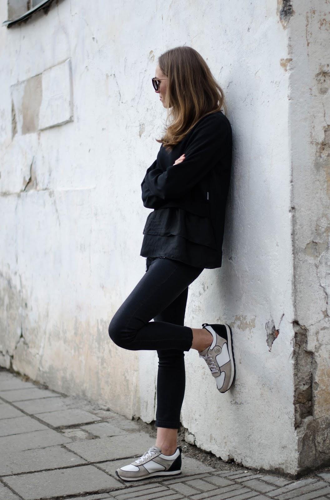 kristjaana mere black sweater jeans sneakers casual spring look