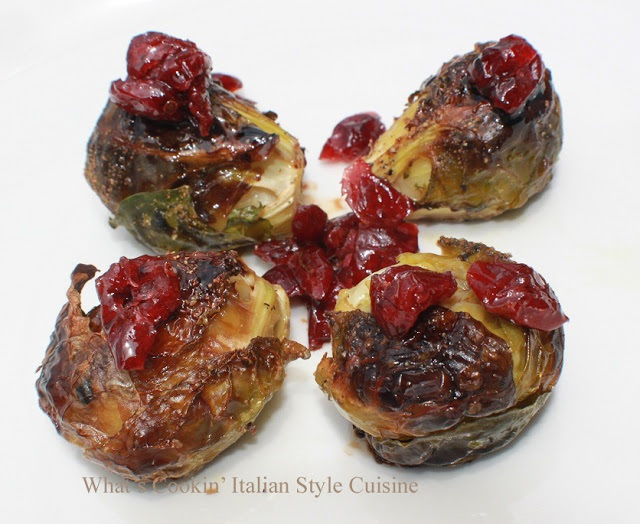 these are mini cabbages roasted in a hot oven with spices then tossed with cranberries and balsamic for a pretty holiday colored table side dish
