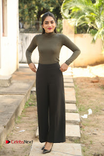 Tollywood Actress Punarnavi Bhupalam Latest Po Gallery in Black Trouser Pant at Pittagoda Movie Interview  0159.JPG