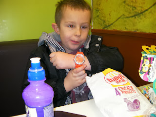 boy with orange wristwatch