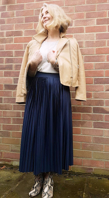 image showing pleated skirt and boots outfit