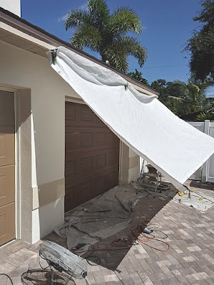 sun tarp for protection while painting a garage door to look like wood