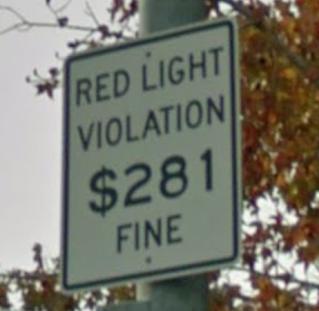 red light violation fine sign $280