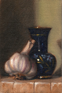 Oil painting of a garlic bulb beside a blue glass vase painted with a floral pattern.