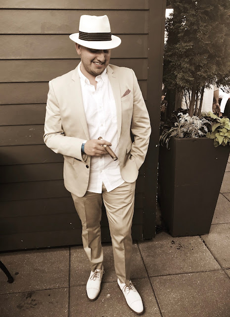 White full suit with snare fedora.