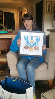Special olympics star Jazz Stagg display her medals