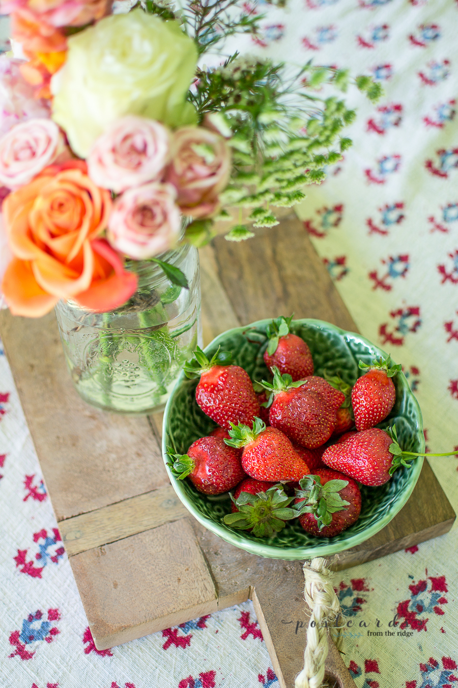 fresh strawberries in a green cabbage bowl