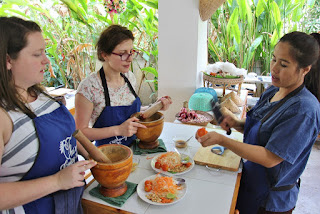 Thai cooking class learning how to make Thai papaya salad