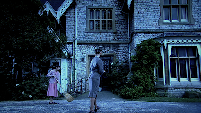 Elise and her broom outside the institution © Roaring Girl Productions