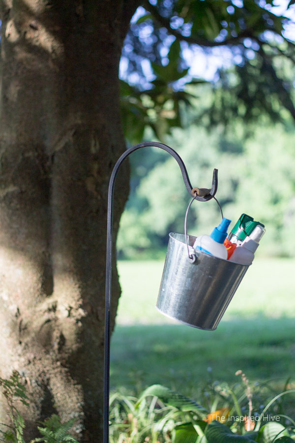 Great idea! Keep bug spray in a bucket and hang on a garden hook. Perfect for outdoor parties.