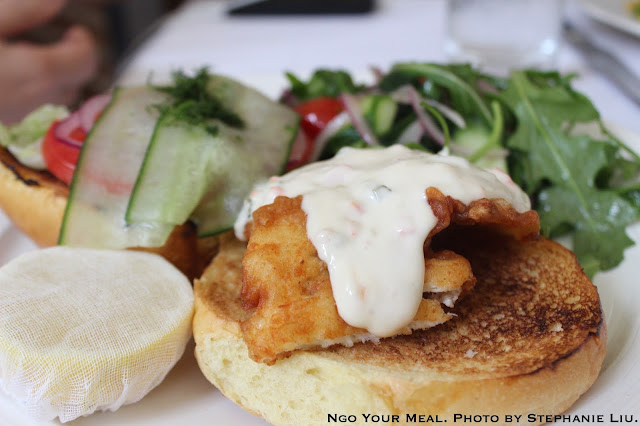 Fish Sandwich, beer battered, sliced red onions, and tzatziki tartar sauce at NERAI