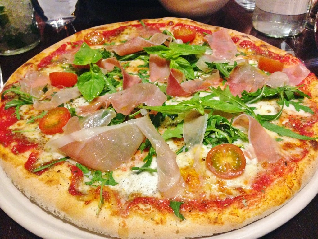 colourful prosciutto, rocket and buffalo mozzarella stone baked pizza