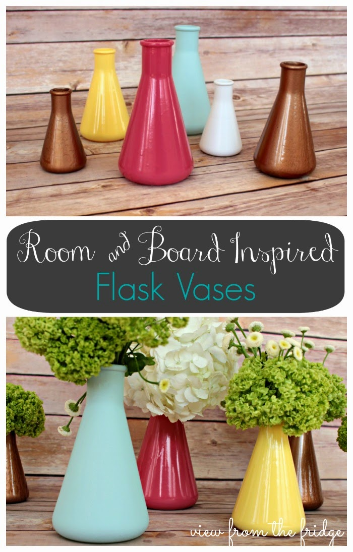 Room and board inspired flask vases on the table.
