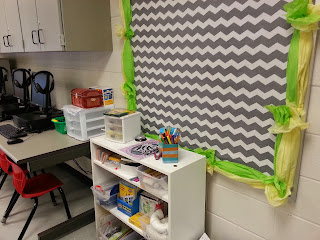Bulletin Board set up with fabric and tissue paper