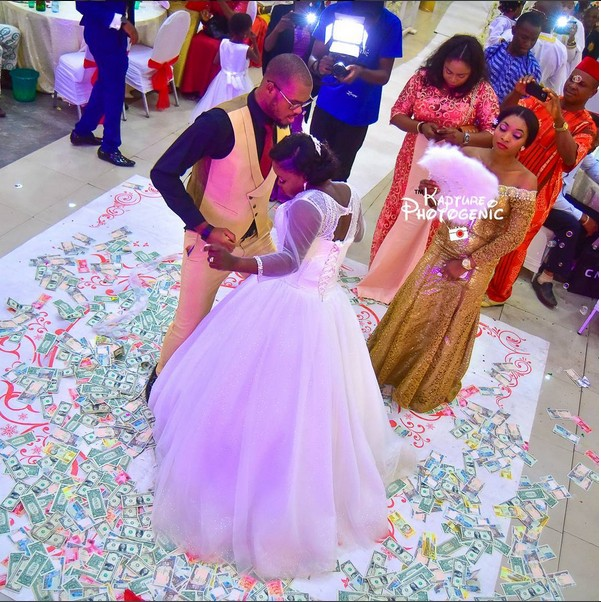 Check out the dollar rain at this Nigerian wedding reception
