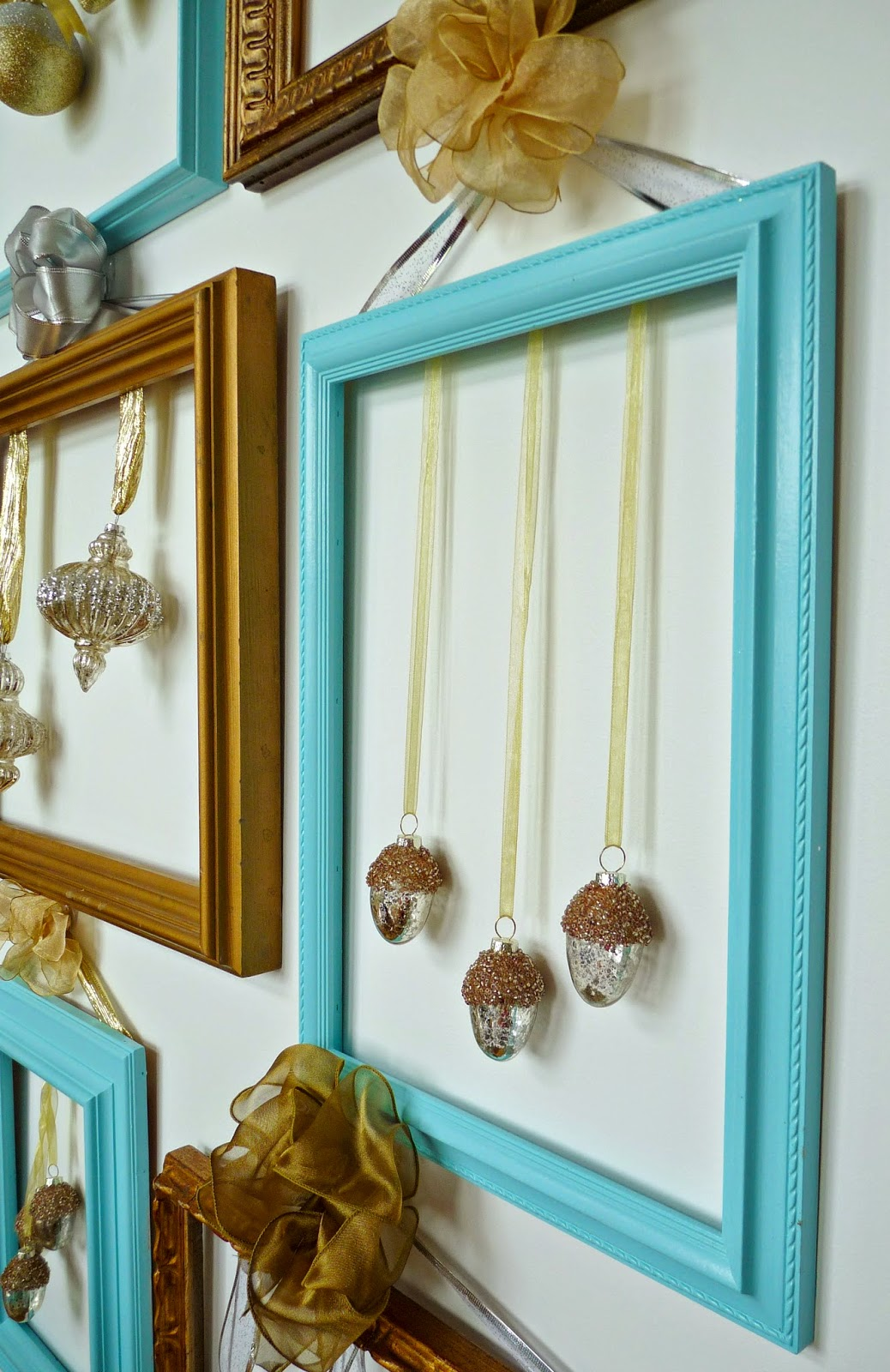 Christmas ornaments displayed on frame