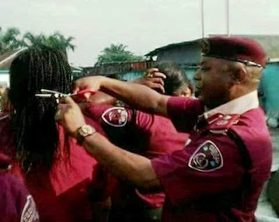 Image result for FRSC commander recalled for cutting off female officers hair extensions