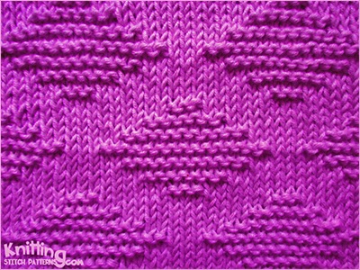 This stitch uses only knit (K) and purl (P) stitches to create a garter diamond pattern.