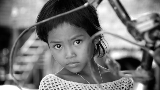 Visage khmer du Jour. Photo ND Strupler