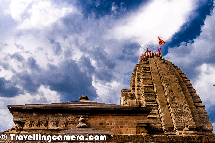 Baijnath is famous for it's old Shiva temple which was built in 13th Centuary. Shiva is considered as 'the Lord of physicians'. Baijnath was originally known as Kiragrama and it lies on Pathankot-Palampur-Manali highway (National Highway No. 20) almost midway between Kangra and Mandi. The present name Baijnath became popular after the name of the temple. The town is located on the left bank of the river Binwa, which is a corrupt form of ancient Binduka(a tributary of river Beas). Let's check out this Photo Journey to know more about this temple in Baijnath...This famous temple of Shiva is very close to main road which connects Palampur with Mandi, via Jogindernagar. Baijnath town is almost on border of Kangra Border. Mandi Boundary starts at around 4-5 kilometers from main town. This temple comes on left as we move from Palampur to Mandi via Baijnath Town.Temple is visible from main road and there is a well maintained garden in it's back. At times, monkeys can also be seen around the temple and this green garden. This temple is on a hill top but there is no climb involved to reach the main campus. On other side of the temple there is a deep valley with wonderful view of flowing river with snow capped hills in background.Overall surroundings of Shiva Temple are pleasing...Temple in current form is a beautiful example of the early medieval north Indian temple architecture known as Nagara style of temples. The Svayambhu form of Sivalinga is enshrined in main temple that has five projections on each side and is surmounted with a tall curvilinear Shikhara.Baijnath is popular for it's ancient temple which is dedicated to Lord Shiva. Neighbouring towns of Baijnath are Palampur in Kangra district and Jogindernagar town in Mandi District.There are two balconies on two sides of main temple which is dedicated to Lord Shiva. Above photograph shows some portions of a balcony..There is a small porch in front of mandapa hall that rests on four pillars in the front preceded by an idol of Nandi, the bull, in a small pillared shrine. Whole temple is enclosed by a high wall with entrances in the south and north. The outer walls of the temple have several niches with images of gods and goddesses. Numerous images are also fixed or carved in the walls.It is believed that durin Treta Yug, Ravana worshiped Lord Shiva in Kailash for getting invincible powers . In the same process, to please the almighty he offered his ten heads in havan kund. Influenced by this extra ordinary deed of Ravana, Lord Shiva not only restored his heads but also bestowed him with powers of invincibility and immortality.Most of the walls around main temple and outer walls have different designed carved out...The temple attracts a large number of tourists and pilgrims from different parts of India and abroad throughout the year. Special prayers are offered in the morning and evening every day besides on special occasions and during festive seasonsSculptures of Chamunda Devi and Kartikey can be seen on the walls of main Shiva Temple. To have very specific details about these designs, check out official website of Baijnath Shiva Temple at http://www.baijnathtemple.com/Makara Sankranti, Maha Shivaratri, Vaisakha Sankranti, Shravana Mondays, etc. are celebrated with great zeal and splendor. A five day state level function is held here on Maha Shivratri every year.More photographs of Baijnath Shiva Temple can be seen at Lonely Planet website - http://www.lonelyplanet.com/travelblogs/751/42834/Baijnath+Shiva+Temple.+Kangra+Valley,+Himachal+Pradesh,+India?destId=356262