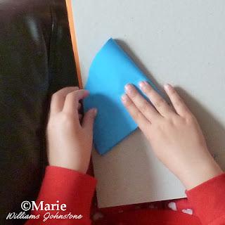 folding the circular paper in half