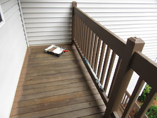 Cutting in 2nd floor deck for painting.