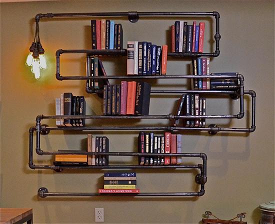 Desain inspiratif rak buku dari pipa bekas