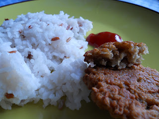 cooked red and white rice mixture