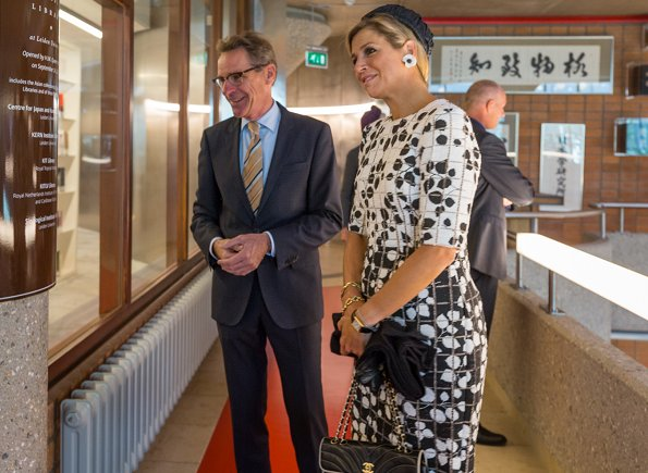 Queen Maxima wore Carolina Herrera Leaf Print Tweed Half Sleeve Dress and Natan pumps, she carried Chanel bag