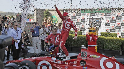 Scott Dixon celebrates atop his car after winning the IndyCar Grand Prix of Sonoma