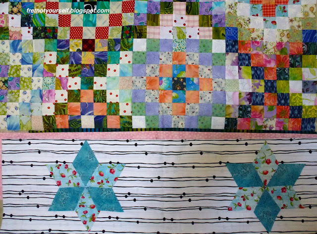 Arranging blue six-pointed stars for a quilt border