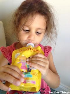 Toddler drinking Nurture drinks